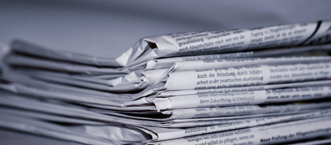 blue folded-newspapers-158651